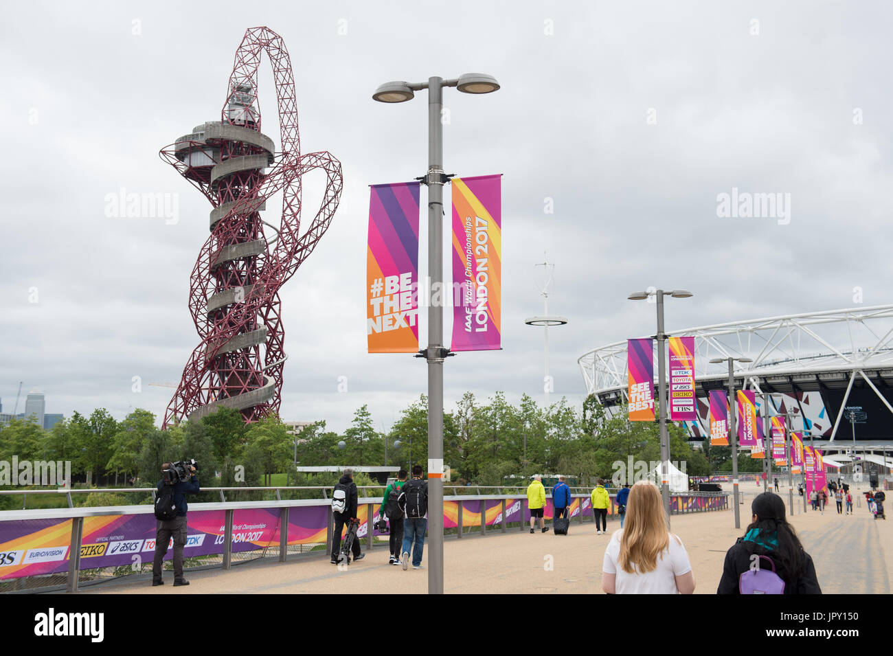 London, UK. 2nd Aug, 2017. People walk by the Olympic Stadium in the Olympic Park in London, Britain, on 2 August Stock Photo