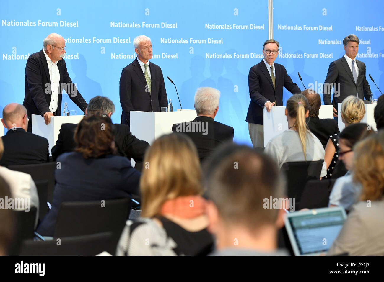 Berlin, Germany. 2nd Aug, 2017. Chairman of the board of Volkswagen Dieter Zetsche (L-R), chairman of the board of Volkswagen AG Matthias Wissmann, president of the German Automobile Industry Association (VdA) Matthias Wissmann, and chairman of the baord of BMW boss Harald Krueger speak during a press conference after the diesel summit in Berlin, Germany, on 2 August, 2017. The aim of the summit was to avoid a ban on diesel vehicles in towns. Credit: dpa picture alliance/Alamy Live News - Stock Image