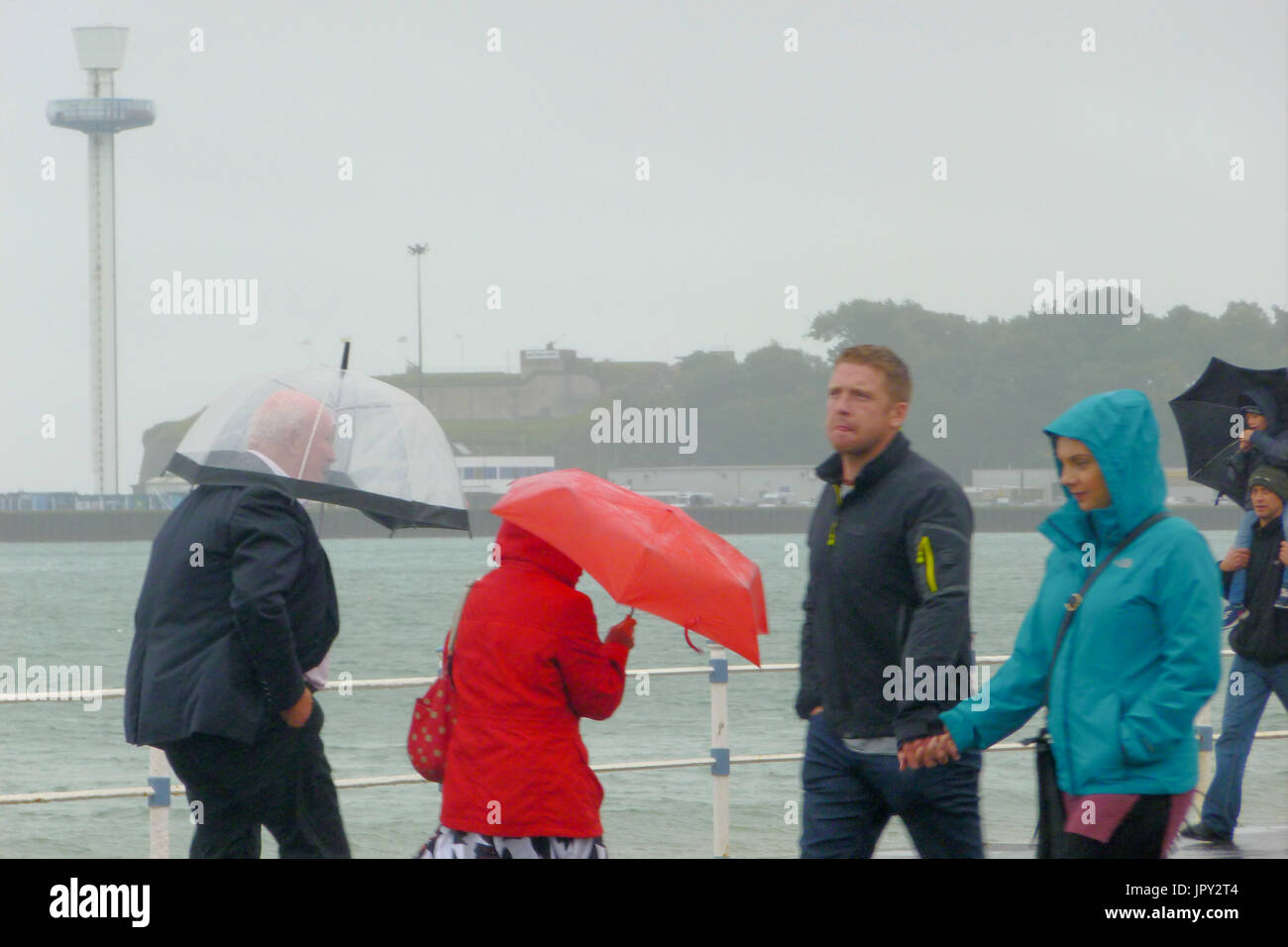 Weymouth, UK. 2nd Aug, 2017. One man's sad face says it all on a day of non-stop rain in Weymouth Credit: stuart fretwell/Alamy Live News - Stock Image