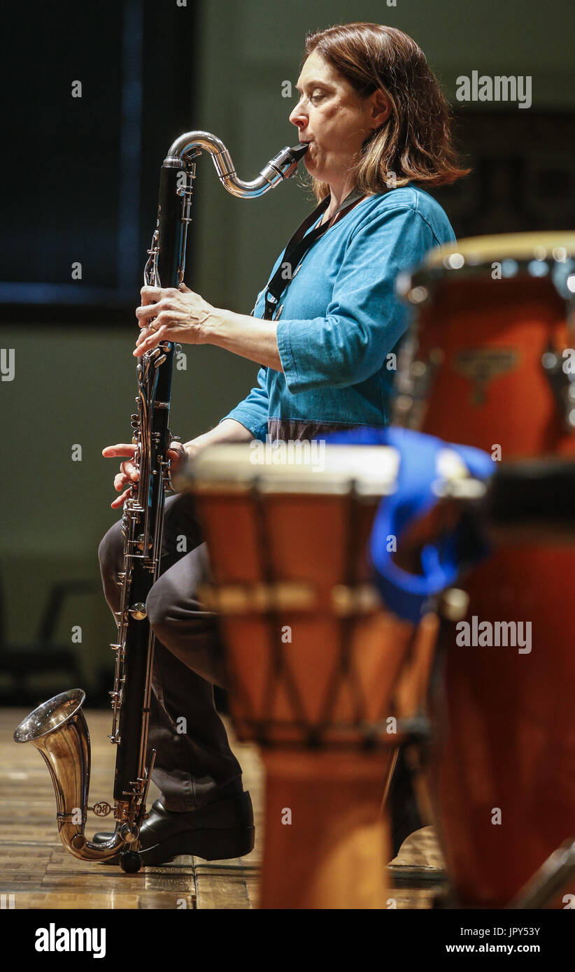 Rock Island, Iowa, USA. 22nd Jan, 2017. Bass Clarinetist Susan Schwaegler plays Prelude in C, BWV 943 composed by Johann S. Bach and Nicholas J. Contorno in Wallenberg Hall at Augustana College in Rock Island on Sunday, January 22, 2017. The Augustana Clarinet Studio presented a recital to benefit Clarinets for Conservation (the Daraja Music Initiative), an organization that strives to preserve the mpingo tree, which is used to make clarinets as well as promoting sustainability through music education in Tanzania. Credit: Andy Abeyta/Quad-City Times/ZUMA Wire/Alamy Live News - Stock Image