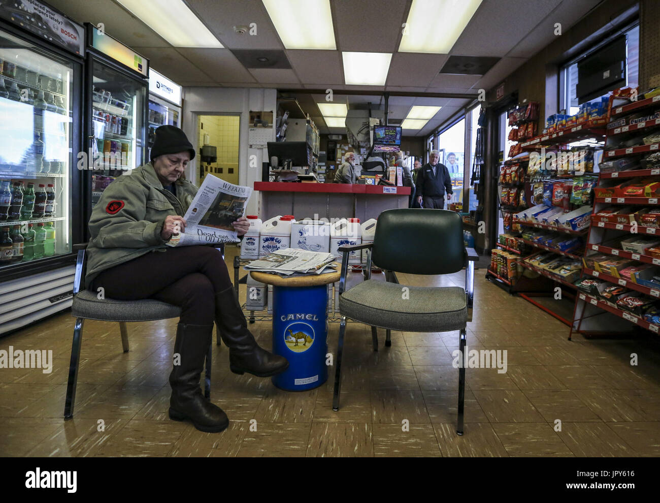 Davenport, Iowa, USA. 19th Jan, 2017. Roxy Dankert of Davenport waits as mechanics patch a tire for her at Dittmer's Service in Davenport on Thursday, January 19, 2017. In January of 2016, the family owned full-service gas station parted ways with Shell Oil Company. The four-pump station lost its big oil affiliation this when the Dittmer brothers refused to conform to the multinational oil and gasoline company's expectations. Credit: Andy Abeyta/Quad-City Times/ZUMA Wire/Alamy Live News - Stock Image