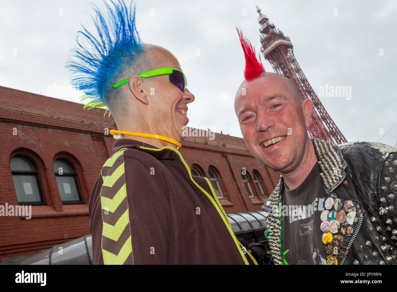 """Blackpool, Lancashire, UK. 3rd August, 2017. Rebellion Festival world's largest punk festival begins as thousands of punks arrive in Blackpool for international punk festival. At the beginning of August, Blackpool's Winter Gardens plays host to a massive line up of punk bands for the 21st edition of Rebellion Festival. There's a fringe fest running alongside the main event. Called """"At the Edge"""" with an art exhibition, vintage clothing and a dedicated Dr Martens stall. Credit; MediaWorldImages/AlamyLiveNews. - Stock Image"""