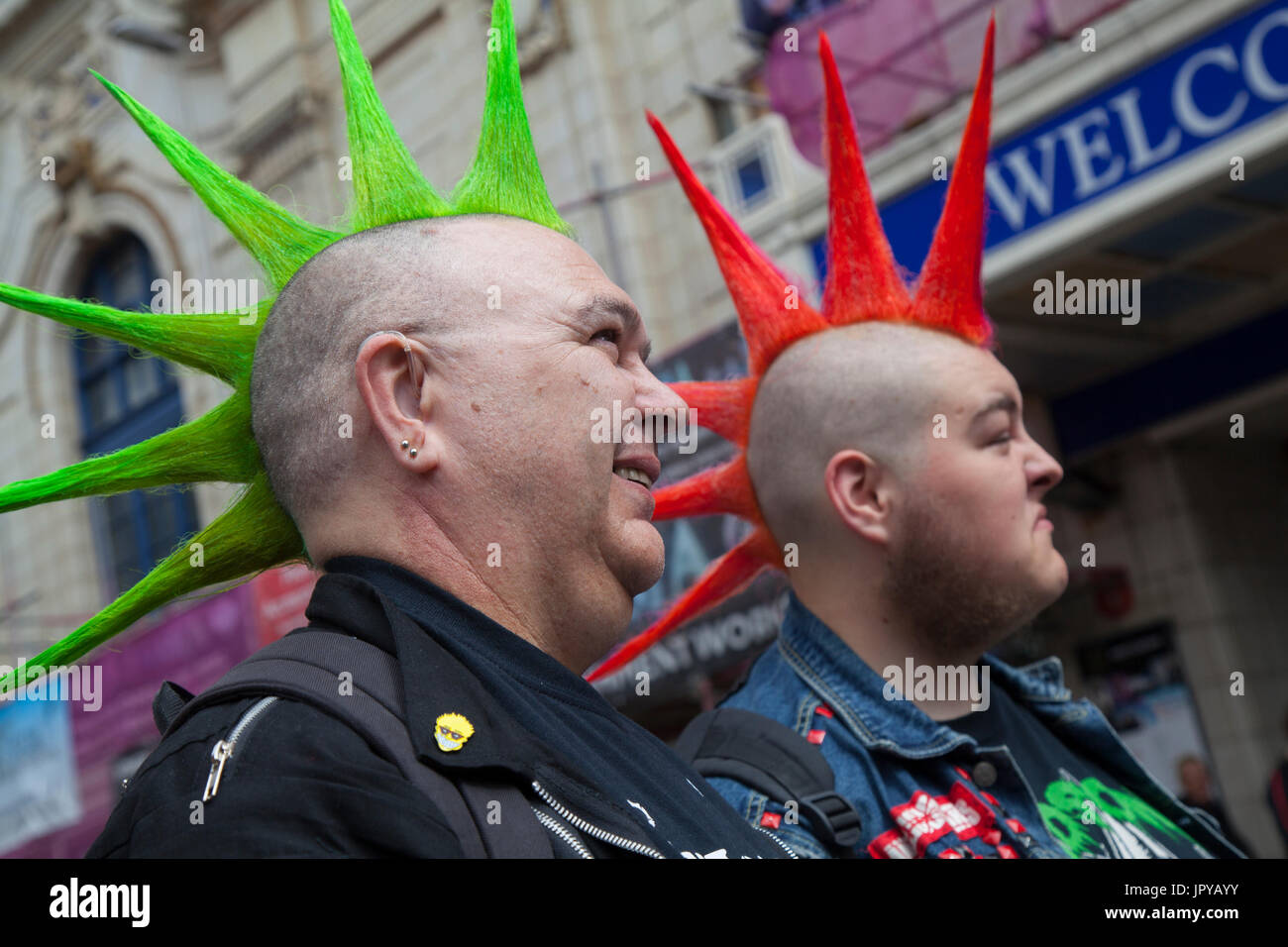 """Blackpool, Lancashire, UK. 3rd August, 2017. Damien & George_Rebellion Festival world's largest punk festival begins as thousands of punks arrive in Blackpool for international punk festival. At the beginning of August, Blackpool's Winter Gardens plays host to a massive line up of punk bands for the 21st edition of Rebellion Festival. There's a fringe fest running alongside the main event. Called """"At the Edge"""" with an art exhibition, vintage clothing and a dedicated Dr Martens stall. Credit; MediaWorldImages/AlamyLiveNews. - Stock Image"""