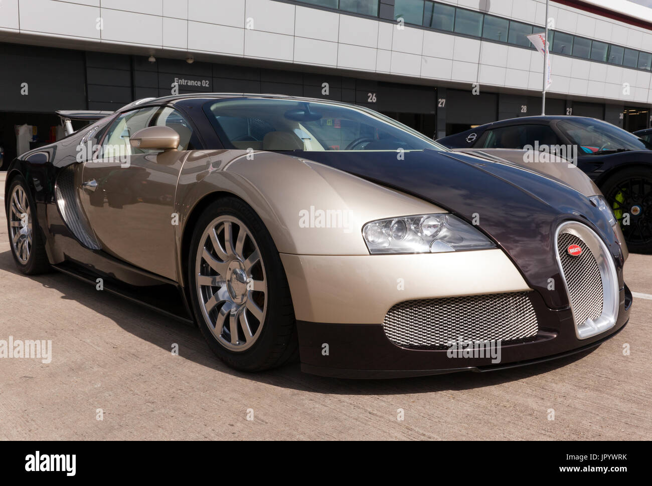 Three-quarter view of a 2007 Bugatti Veyron EB 16.4 on static display in the International Paddock at the 2017 Silverstone Classic - Stock Image