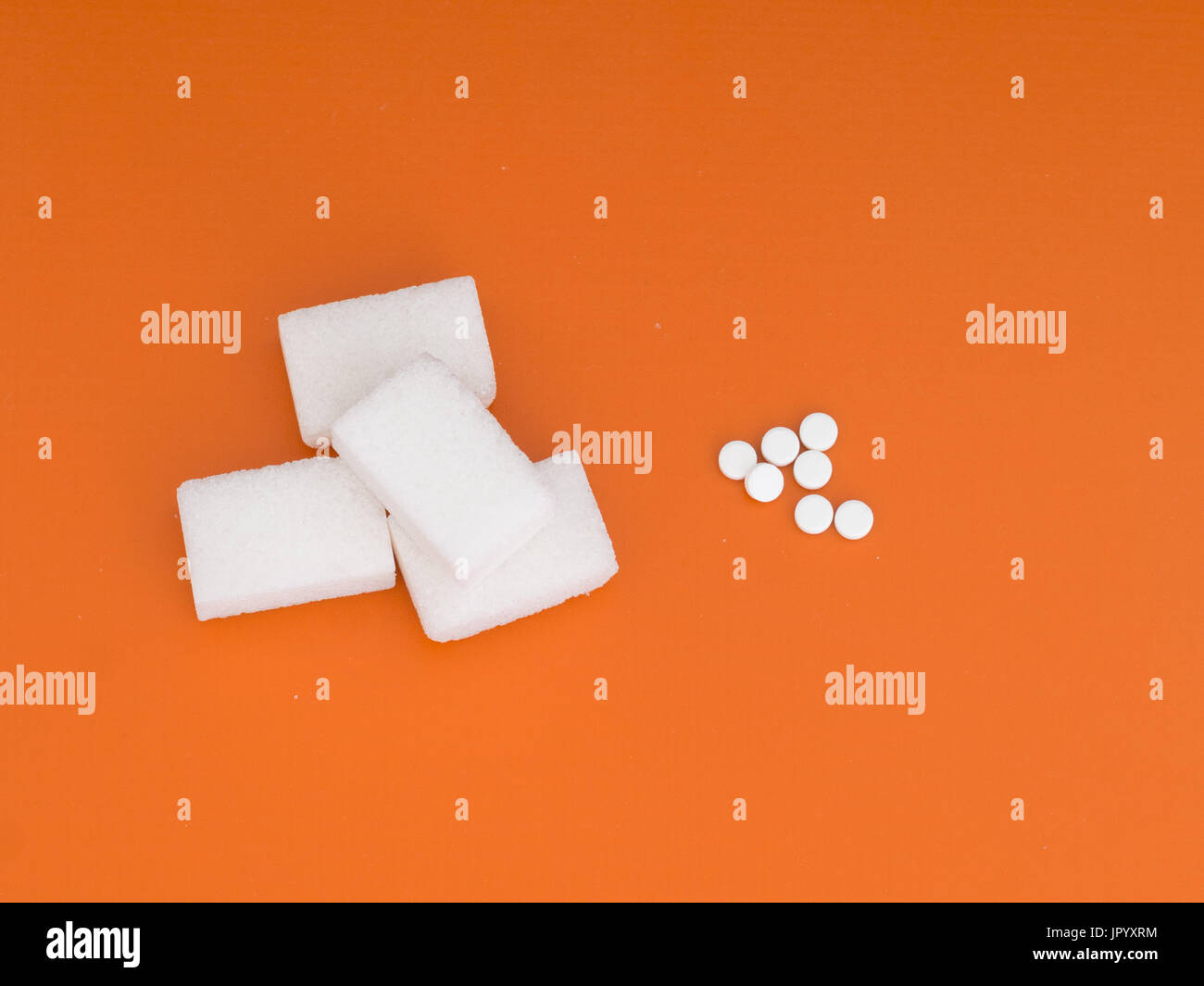 Diet decision. Sugar or aspartame sweetener. - Stock Image