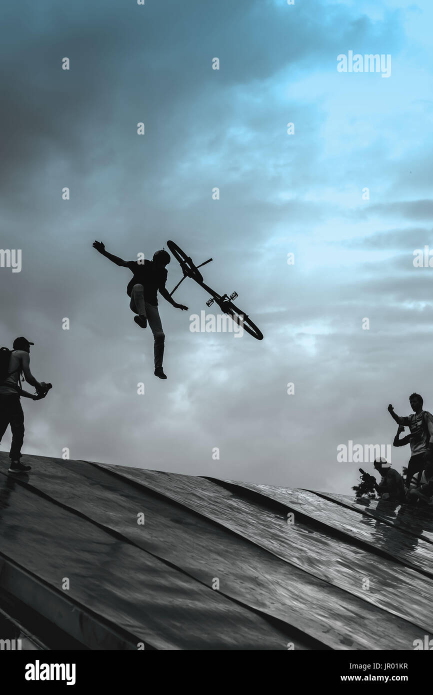 Extrem Sport and risk. Unsuccessful performance at competitions. Fall from BMX bike. Risky moment of falling falls into frames of photo correspondents - Stock Image