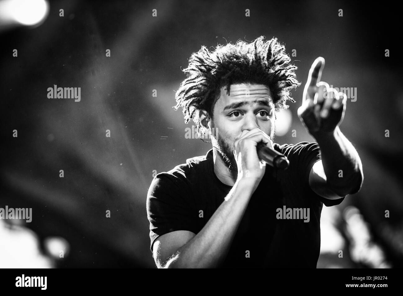 J cole performing at a music festival in british columbia canada in black and white