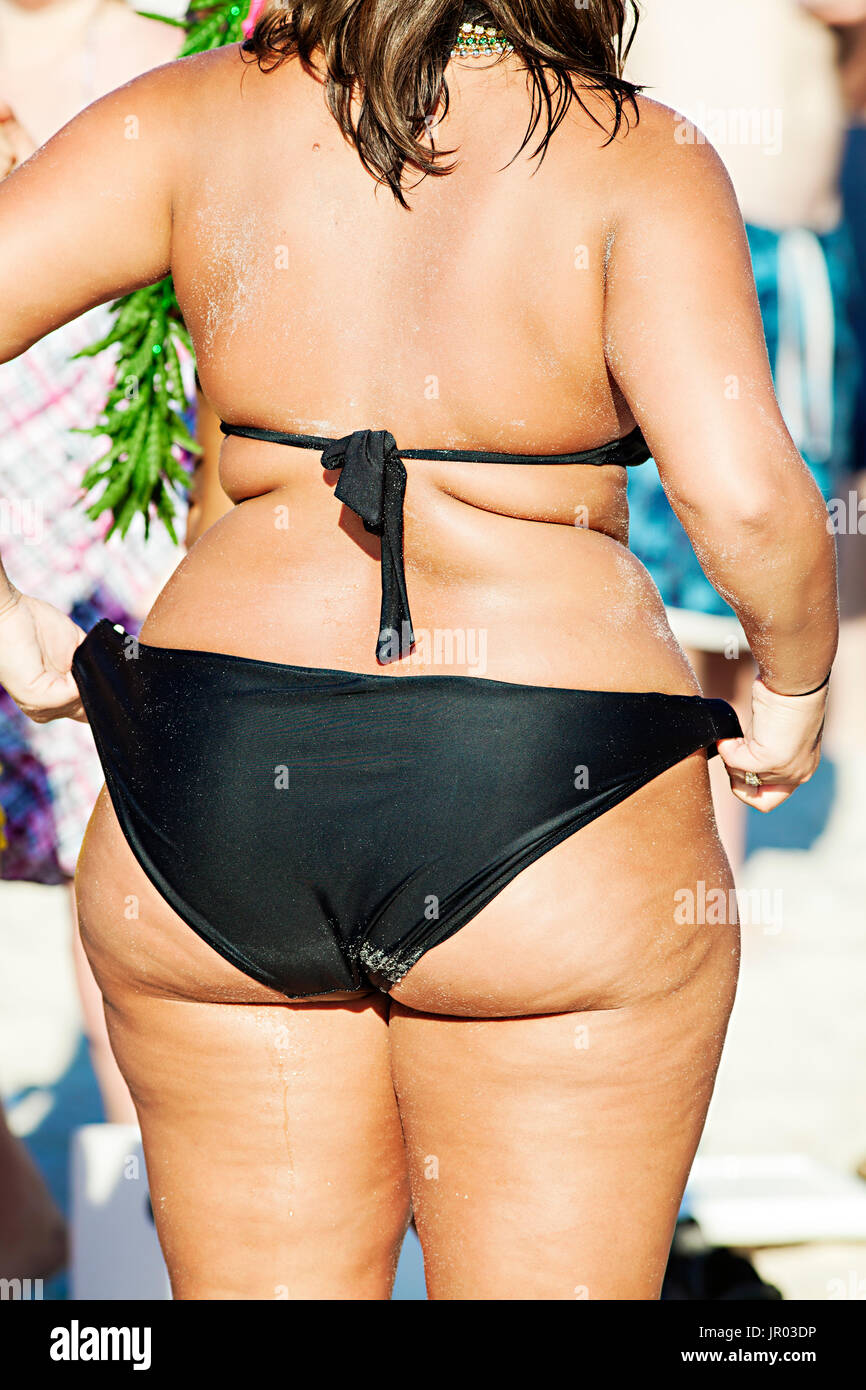 Chubby girls in bikinis at beach