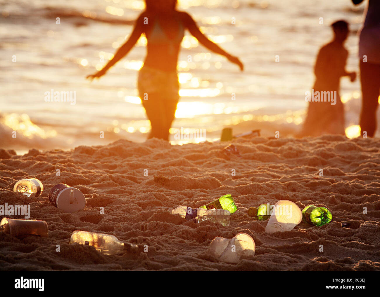 Plastic litter left behind by spring breakers at Panama City Beach, Florida. - Stock Image