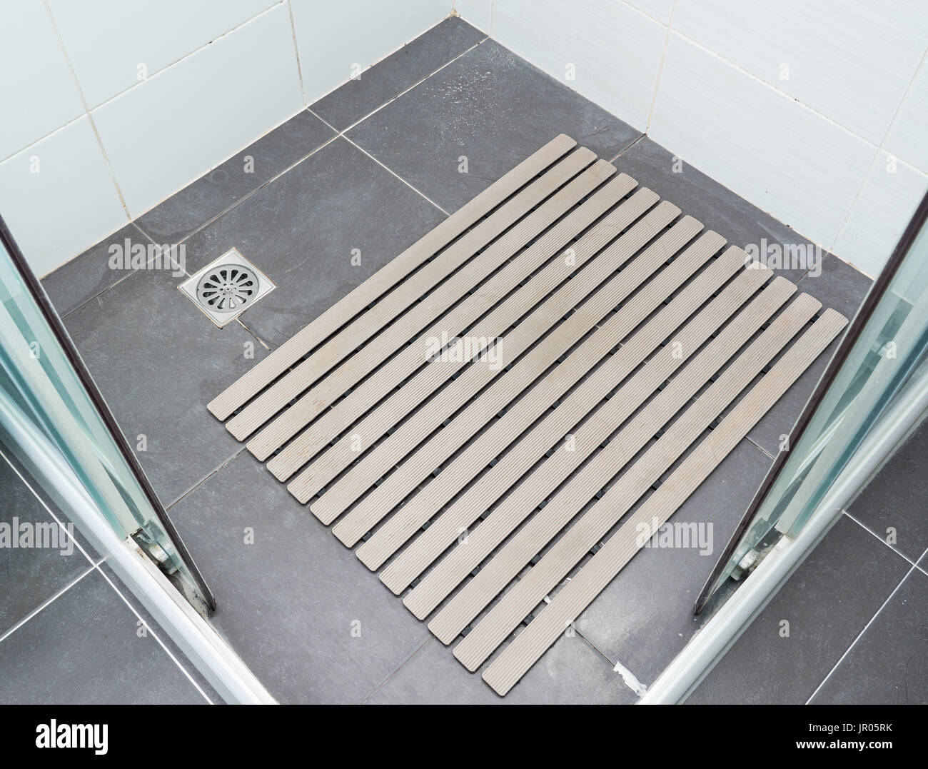 Rubber Slip Pad With The Many Hair Pieces In The Shower Stall Of The Modern  House