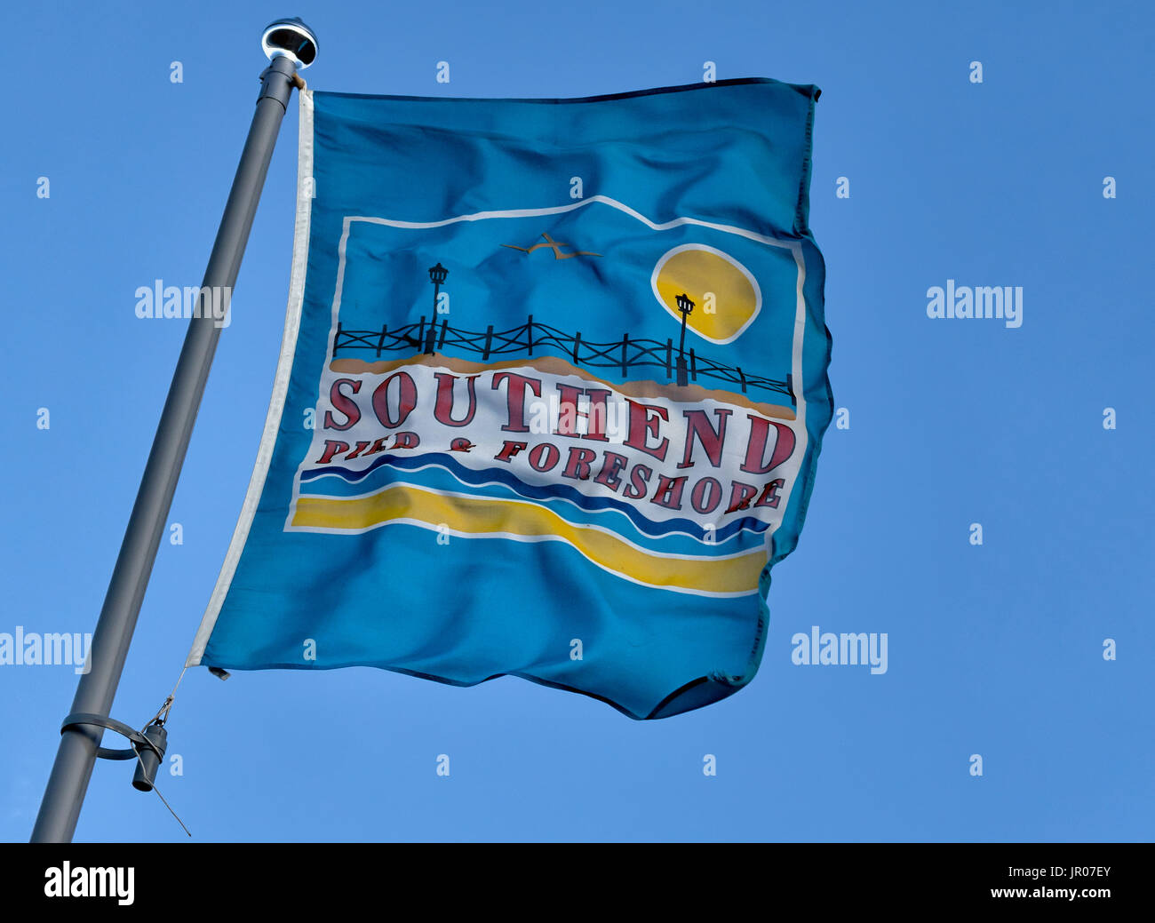SOUTHEND-ON-SEA, ESSEX, UK:  Flag banner advertising Southend Pier and Foreshore blowing in the wind - Stock Image