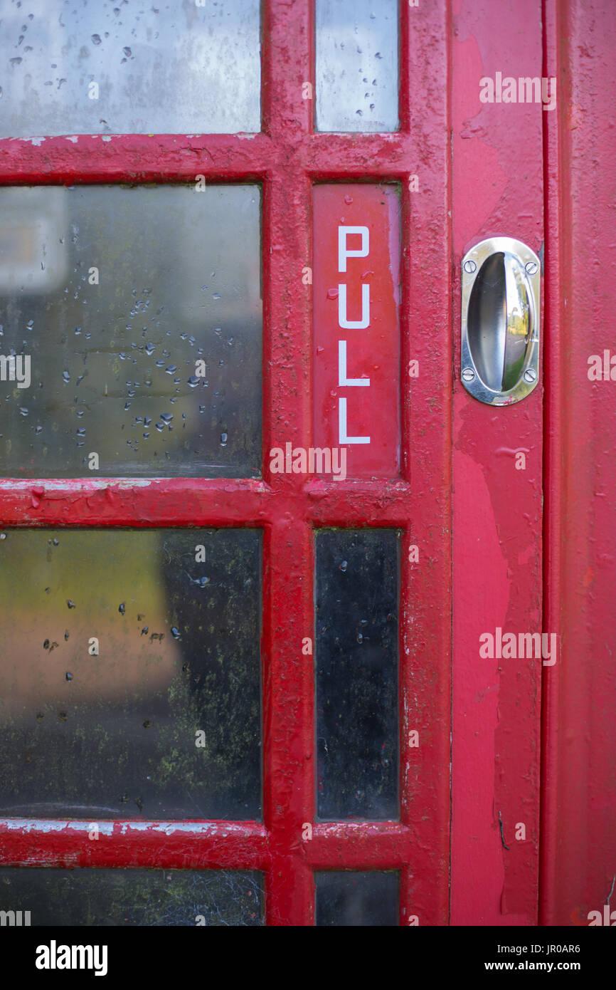 Red Telephone Box in London when raining - Stock Image