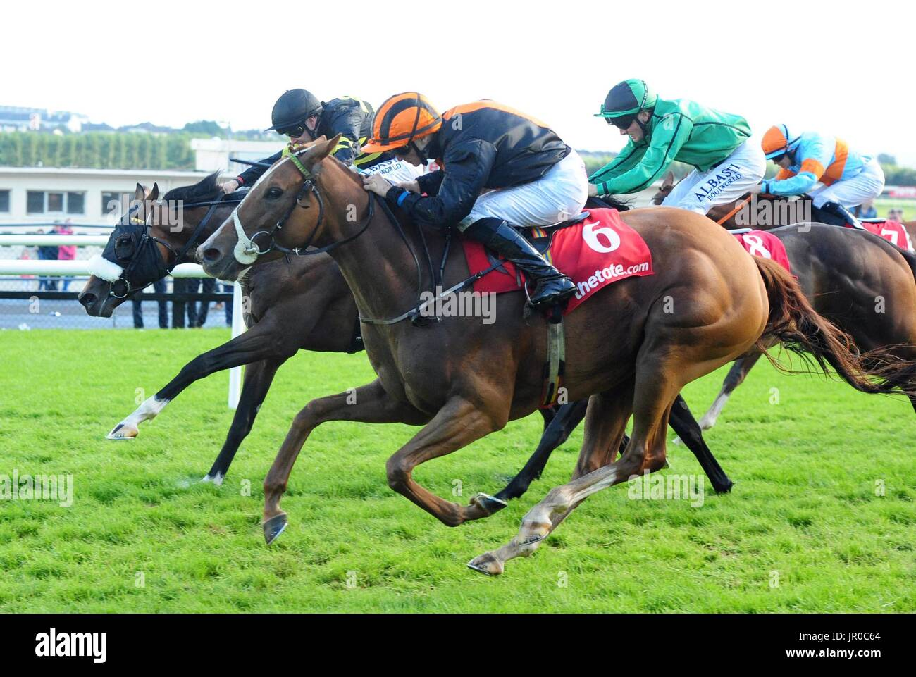 Jet Streaming ridden by Danny Sheehy (no.6) wins the Win Big With Tote Handicap during day three of the Galway Summer Stock Photo