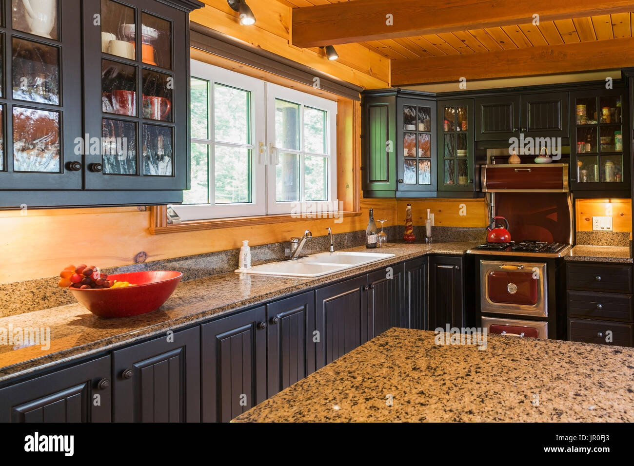 Kitchen With Black Wooden Cabinets Antique Cooking Stove And Granite Stock Photo Alamy