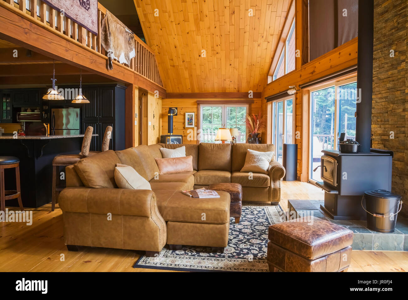 tan leather sectional sofa in living room with view of kitchen and rh alamy com Country Cottage Furniture Cottage Furniture