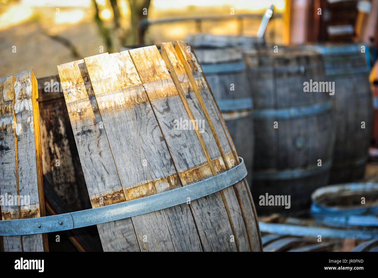 Calistoga Ranch Resort, Calistoga, CA Oct. 1, 2010.  No longer used for aging and storing wine, these barrels age by a pond on the Calistoga Resort. - Stock Image