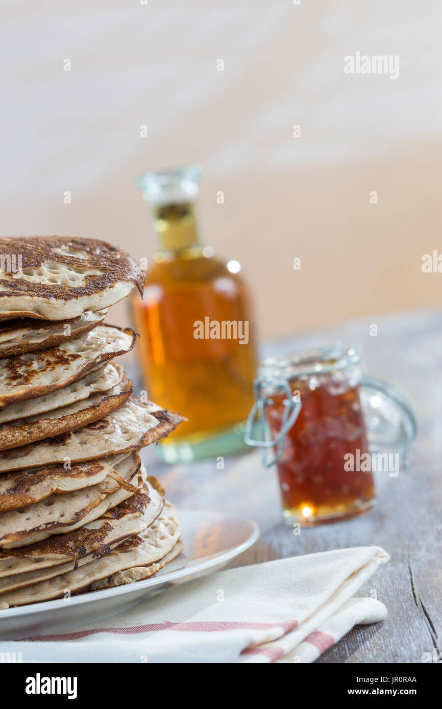 Glutten-free pancakes with jam and Maple syrup, bio healthy ingredients, on white - Stock Image