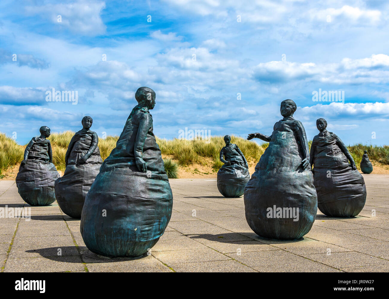 sculptors by juan munoz located at the mouth of the river Tyne at South Shields - Stock Image