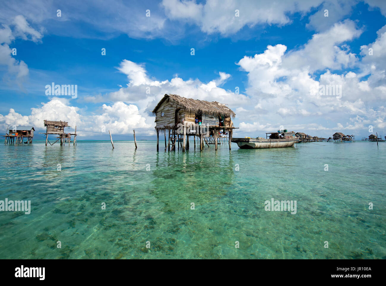Semporna, Malaysia - 19 April, 2015: A Bajau floating village of stilted houses off the coast of Borneo in The Celebes Stock Photo