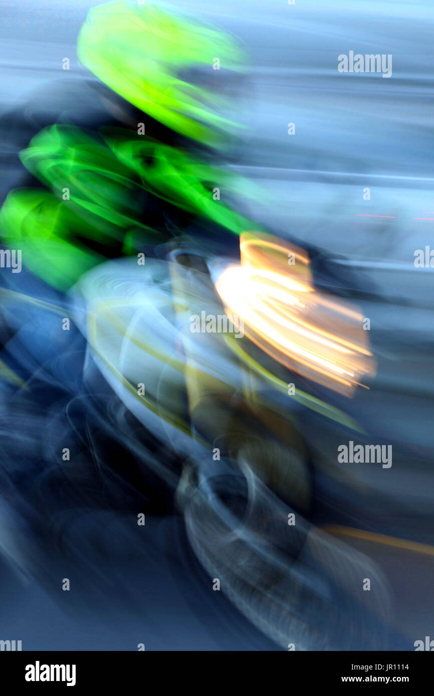 Blurred motion motorcycle on highway - Stock Image