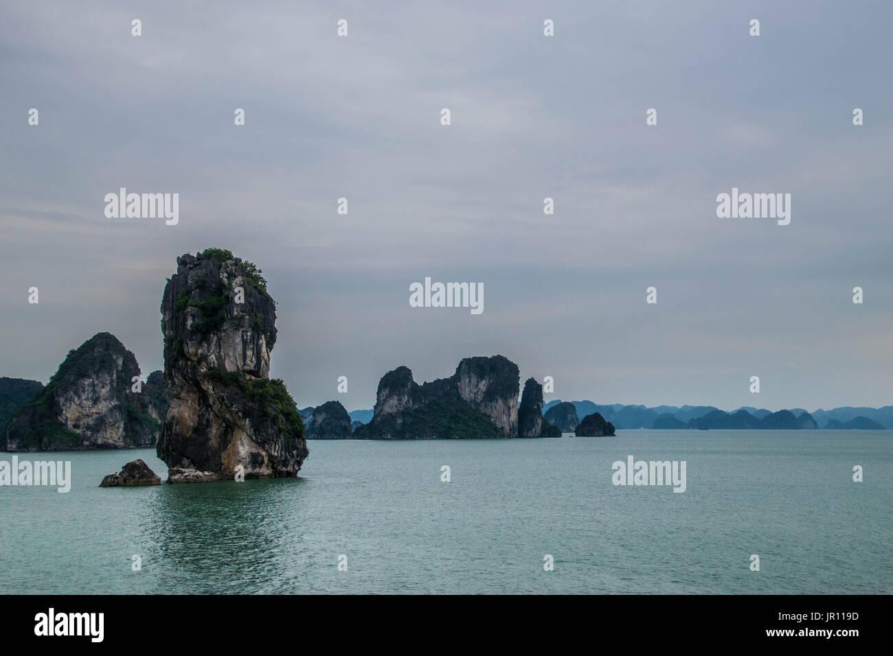 A limestone rock stack, in Ha Long Bay, Vietnam - Stock Image