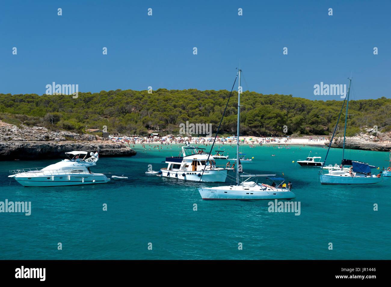 Expensive yachts anchored in Cala Mondrago, Mallorca, Spain - Stock Image