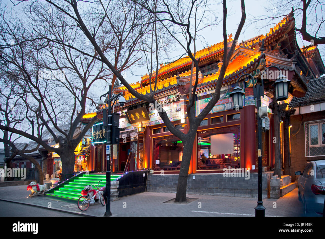 Resplendant in its early evening lights and neon, a restaurant awaits customers in the Shichahai (Houhai) District at Twilight, Beijing, China. - Stock Image