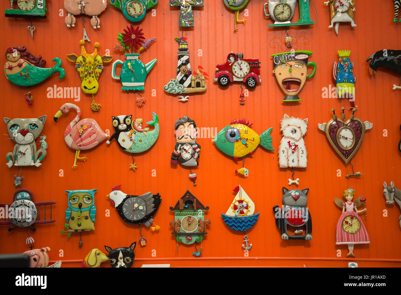 Decorative and quirky clocks for sale. - Stock Image