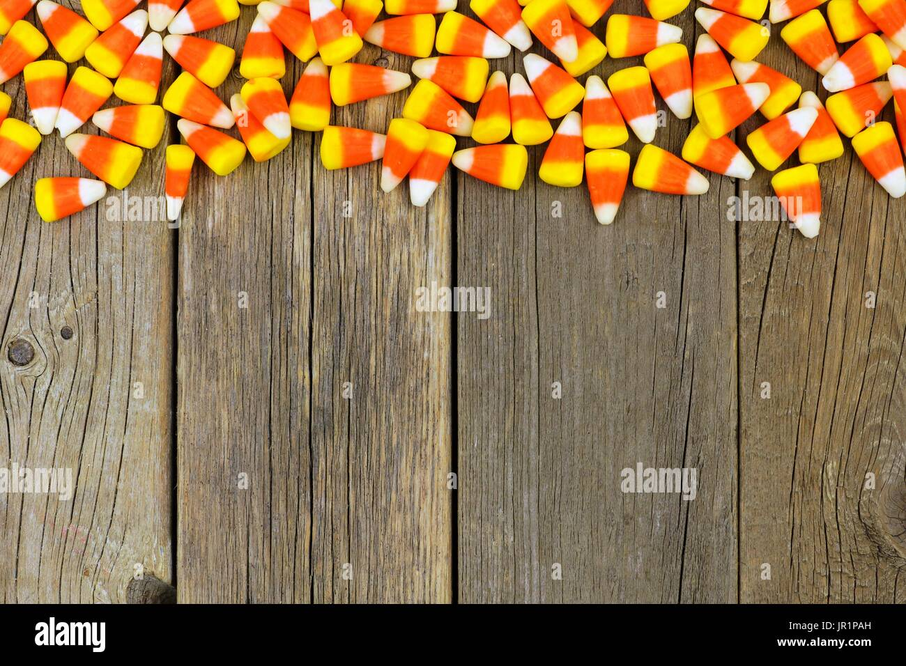Halloween Candy Corn Top Border Against A Rustic Wood Background