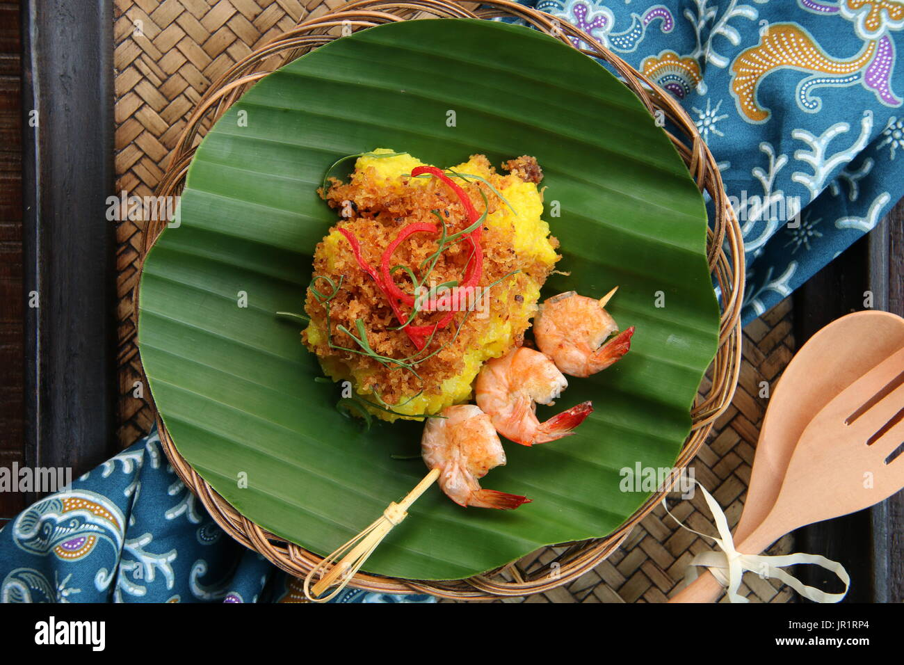 Ketan Serundeng Udang. Turmeric Sticky Rice with Roasted Coconut and Shrimp Satay - Stock Image