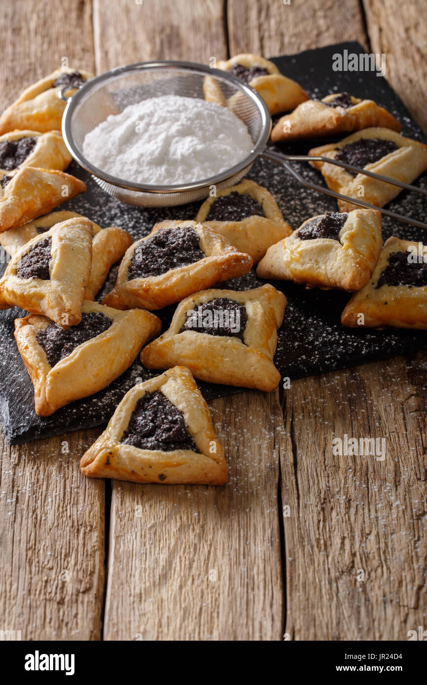 Backed Hamentashen, Ozen Haman, Purim cookies for the Jewish holiday Purim close-up on the table. Vertical - Stock Image