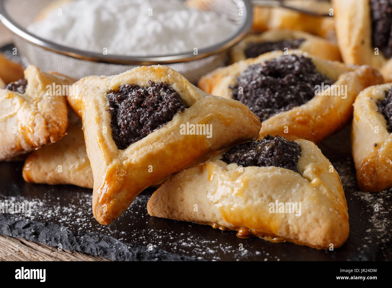 Hamantaschen cookies or hamans ears Purim celebration closeup on the table. Horizontal - Stock Image