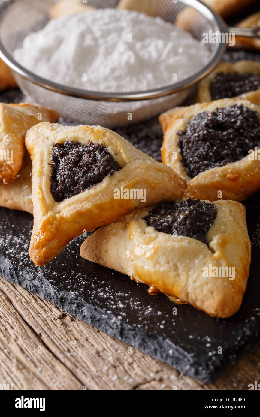 Hamantaschen cookies or hamans ears Purim celebration (jewish holiday) closeup on the table. Vertical - Stock Image