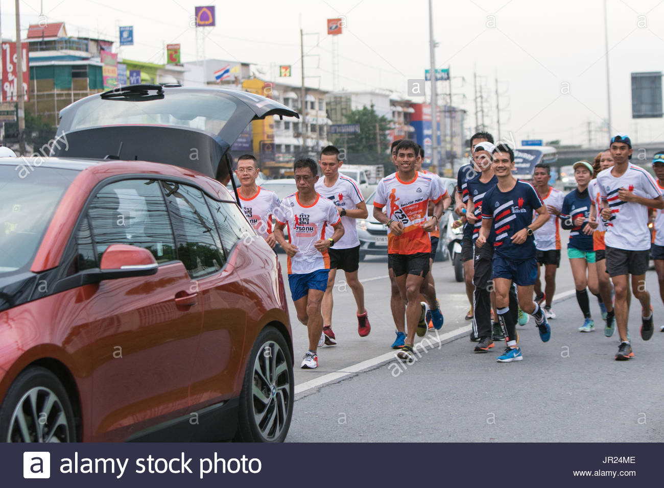 Pathumthani Thailand - July 30 : 'KruDin' Sathavorn Chanpongsri Former Thai national athlete run 750 km, from Bangkok to Phayao, charity for Phayao sc - Stock Image