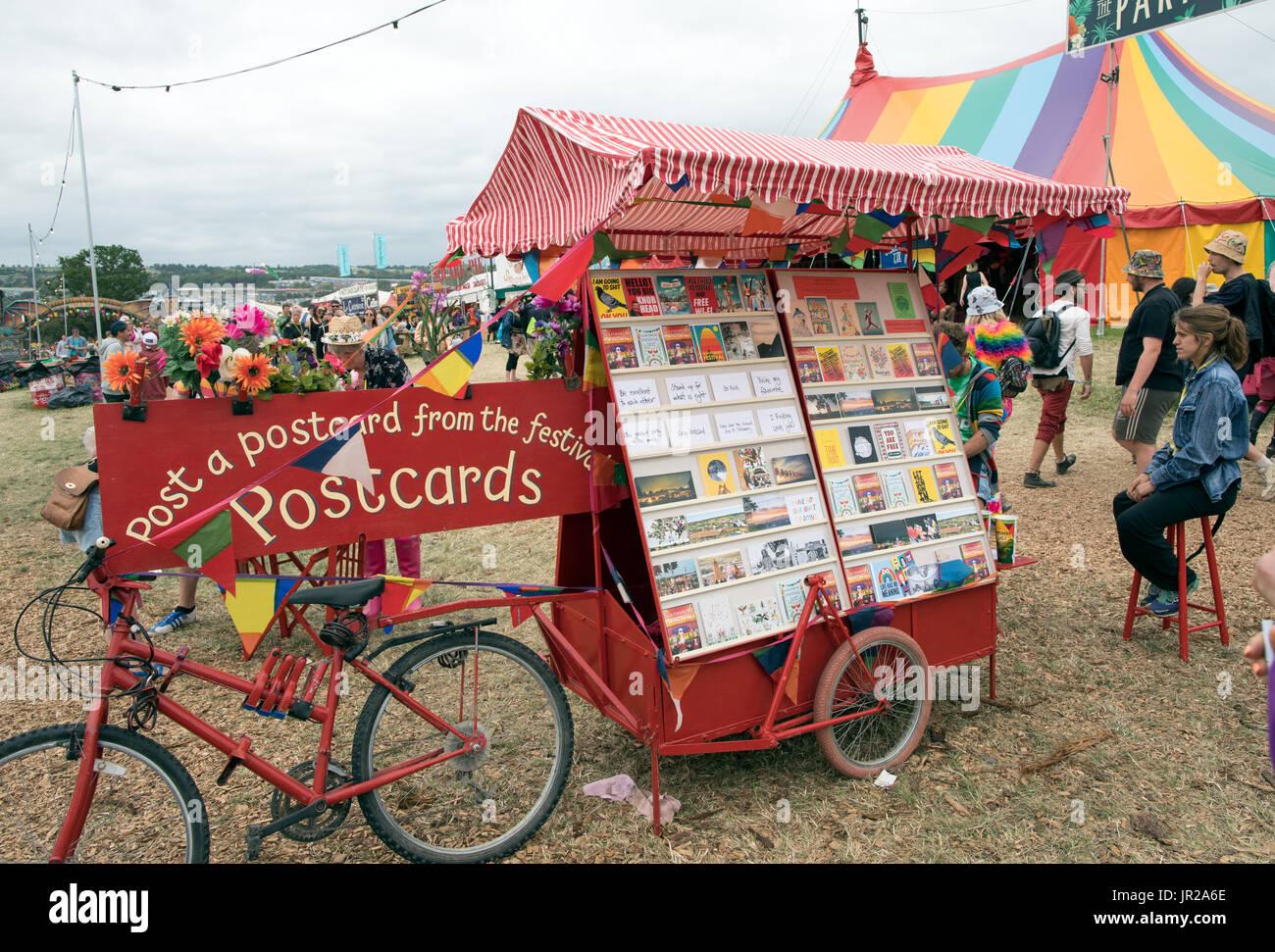 People Sending Postcards From Glastonbury Festival UK - Stock Image