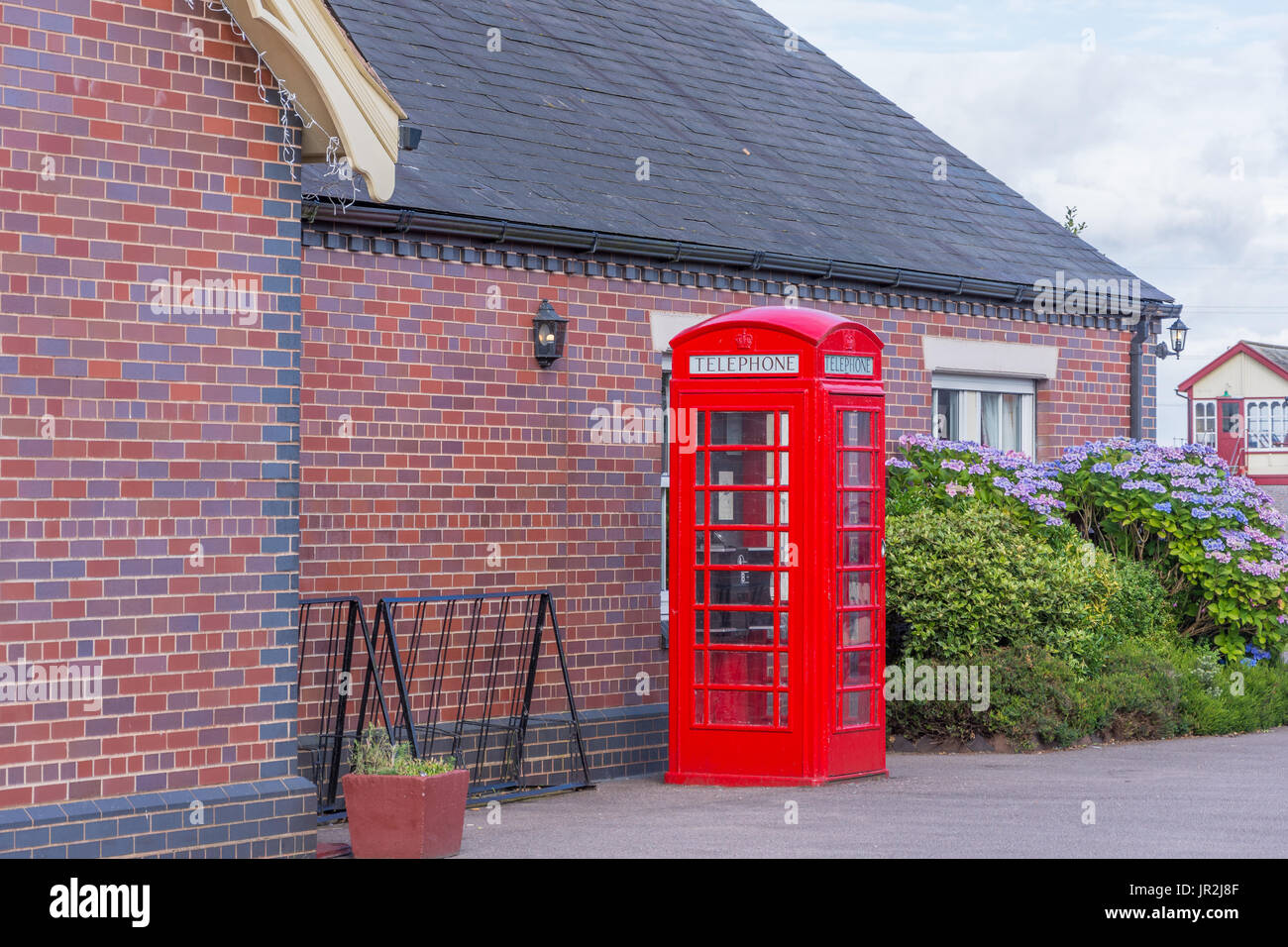vintage style red telephone box - Stock Image