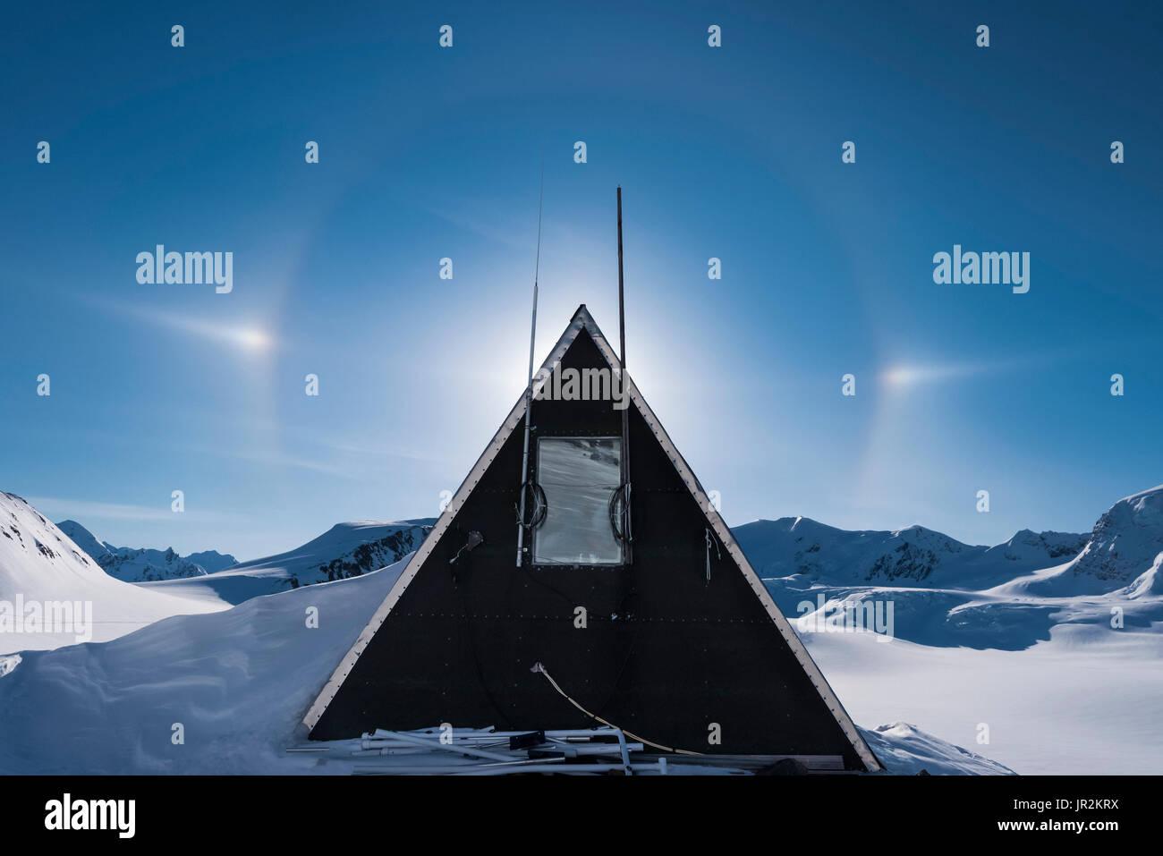 Sundog Frames The Pointed Peak Of A Usgs Gulkana Glacier Research Hut, Interior Alaska, USA - Stock Image