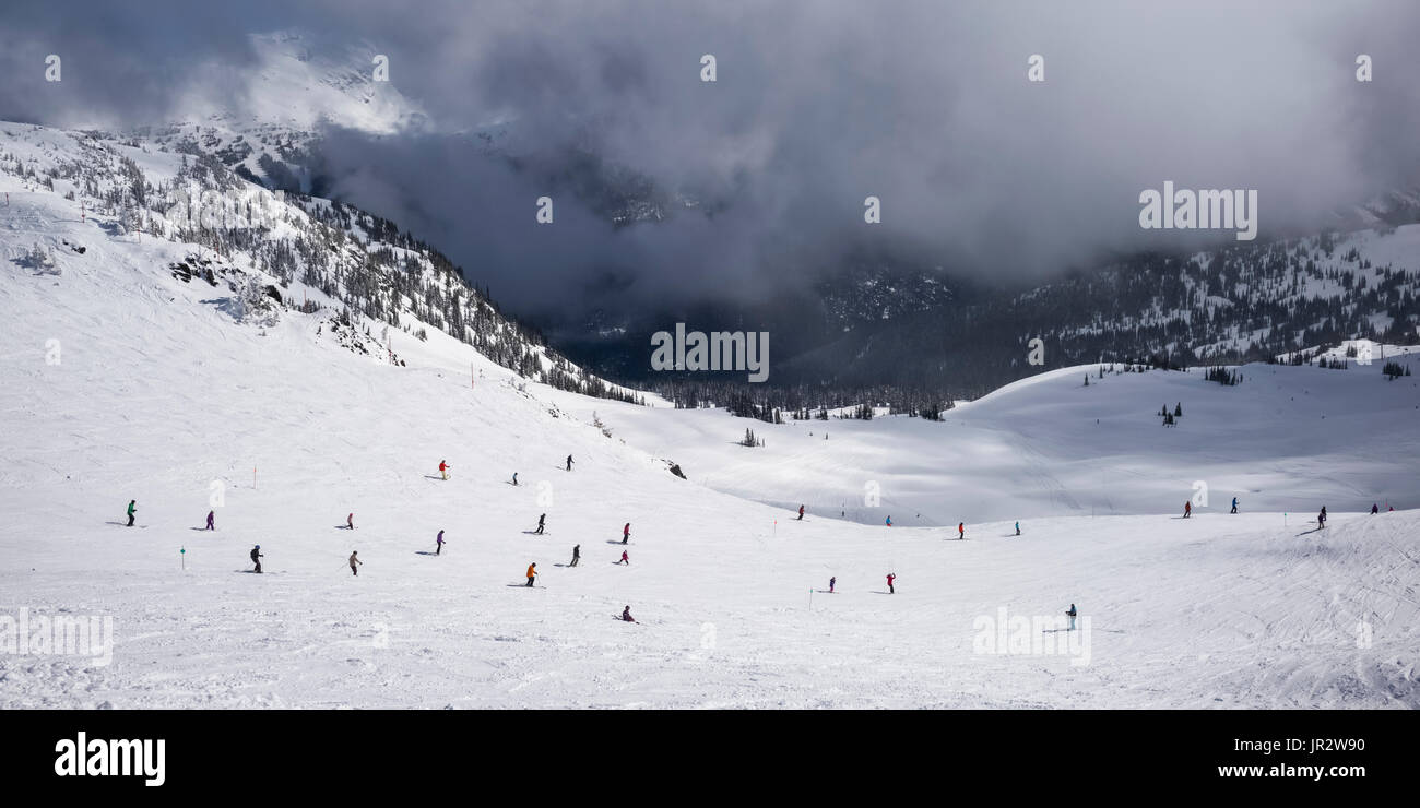 Downhill Skiers At A Ski Resort; Whistler, British Columbia, Canada - Stock Image