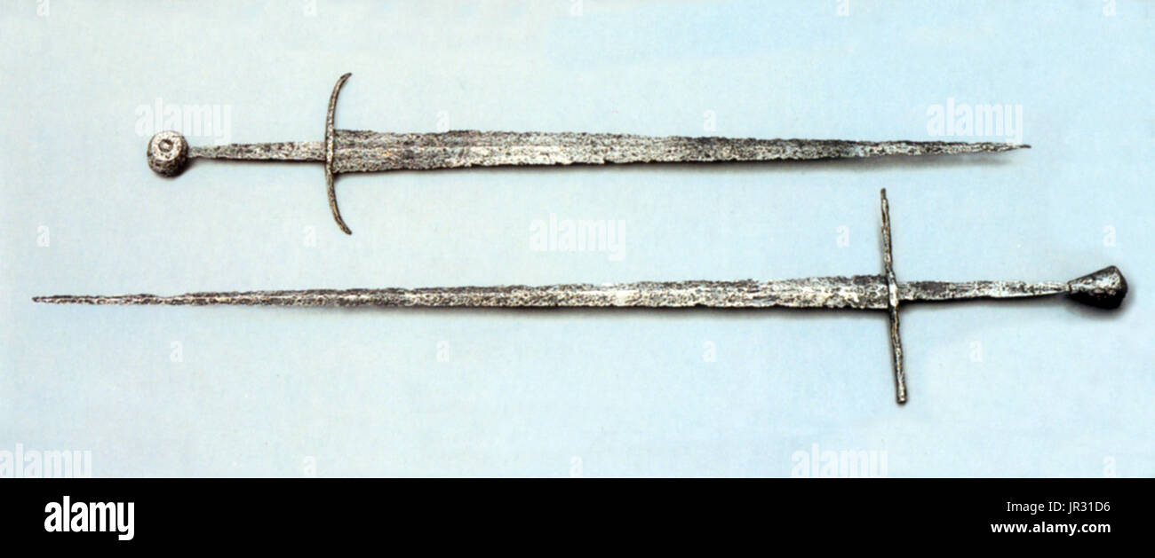 The Arming sword (Knightly sword) was the most widespread type of sword in the European High Middle Ages. It was a straight, double-edged weapon with a single-handed cruciform hilt and a blade length of about 28 to 31 inches. The type is frequently depicted in period artwork, and numerous examples have been preserved archeologically. The high medieval sword of the Romanesque period (10th-13th centuries) develops gradually from the Carolingian sword (spatha) of the 9th century. In the Late Medieval period (14th and 15th centuries), late forms of these swords continued to be used, but often as a - Stock Image
