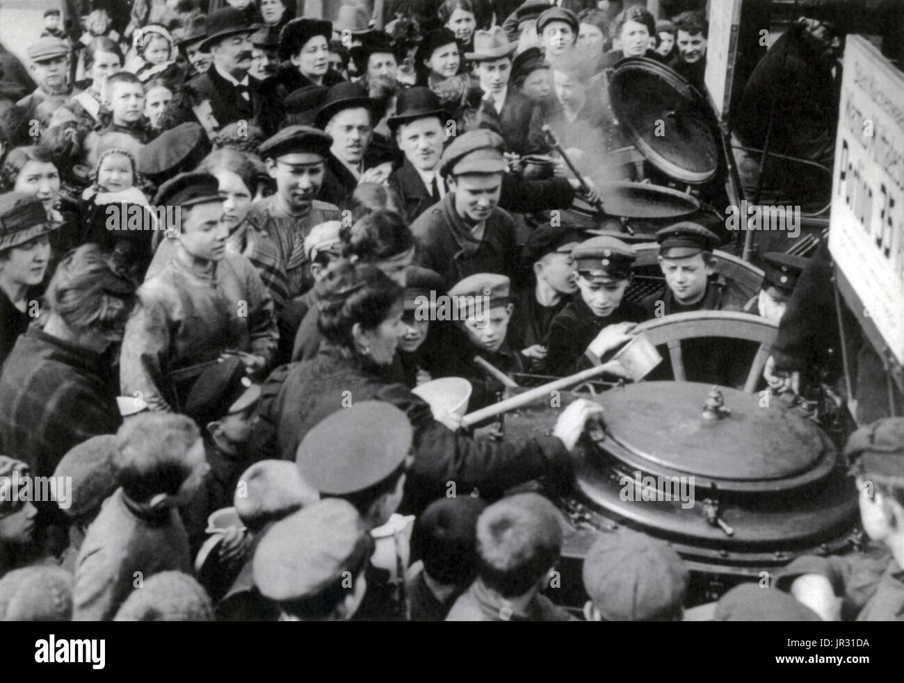 People waiting for soup in Berlin, 1916. The Blockade of Germany, from 1914-19, was a prolonged naval operation conducted by the Allied Powers during and after WWI in an effort to restrict the maritime supply of goods to the Central Powers. It is considered one of the key elements in the eventual Allied victory in the war. The German government made strong attempts to counter the effects of the blockade; a complicated rationing system initially introduced in January 1915 aimed to ensure that a minimum nutritional need was met, with 'war kitchens' providing cheap mass meals to impoverished civi - Stock Image
