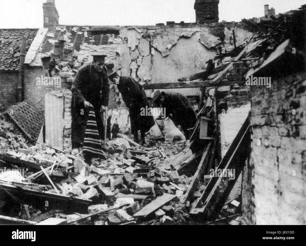 Zeppelin damage in Yarmouth. During WWI Great Yarmouth suffered the first aerial bombardment in the UK, by Zeppelin L3 on January 19, 1915. Bombing missions, especially those targeting London, captured the German public's imagination, but had little significant material success, although the Zeppelin raids, together with the later bombing raids carried out by aeroplanes, did cause the diversion of men and equipment from the Western Front and fear of the raids had some effect on industrial production. - Stock Image