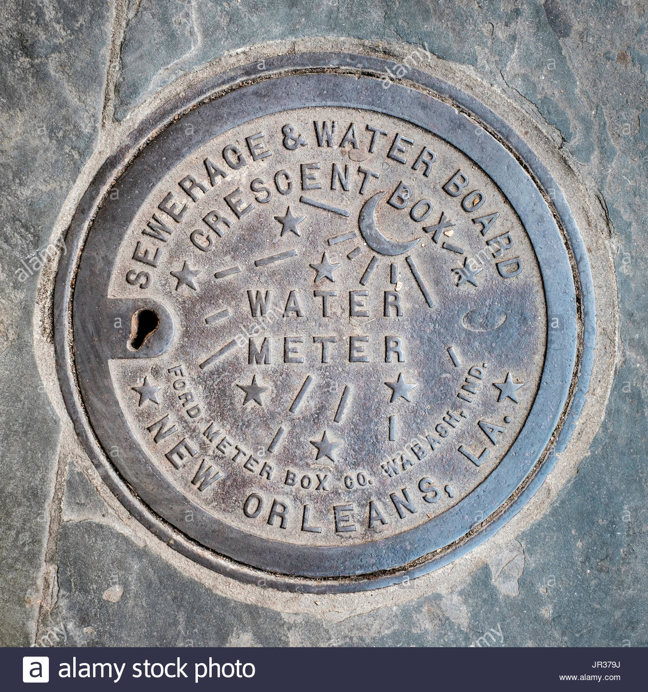 United States, Louisiana, New Orleans, French Quarter. Vintage water meter cover, Sewerage and Water Board. - Stock Image