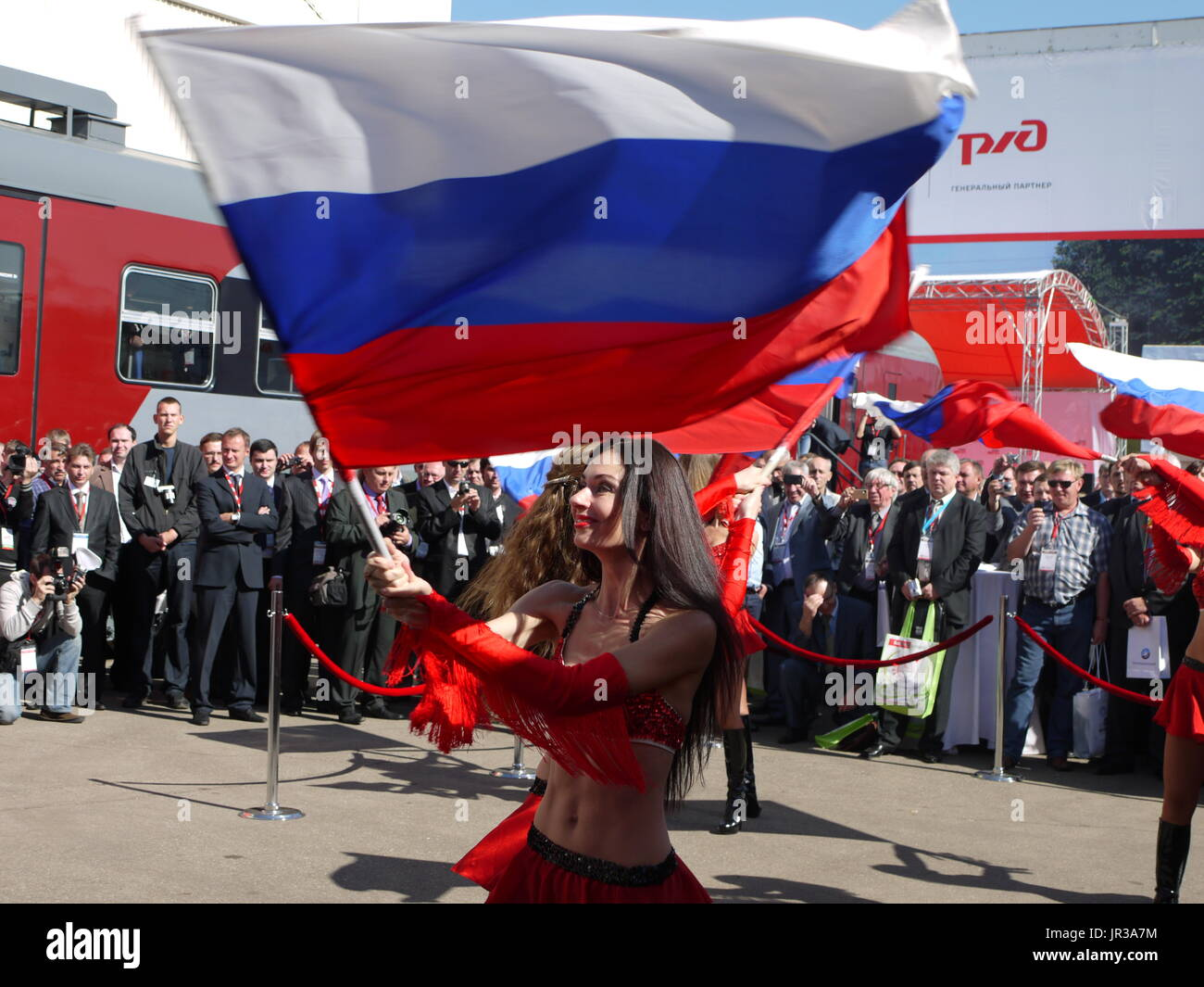 Girl wave a russian flag during oppening ceremony of the annual meeting of railways industry in Moscow - Stock Image