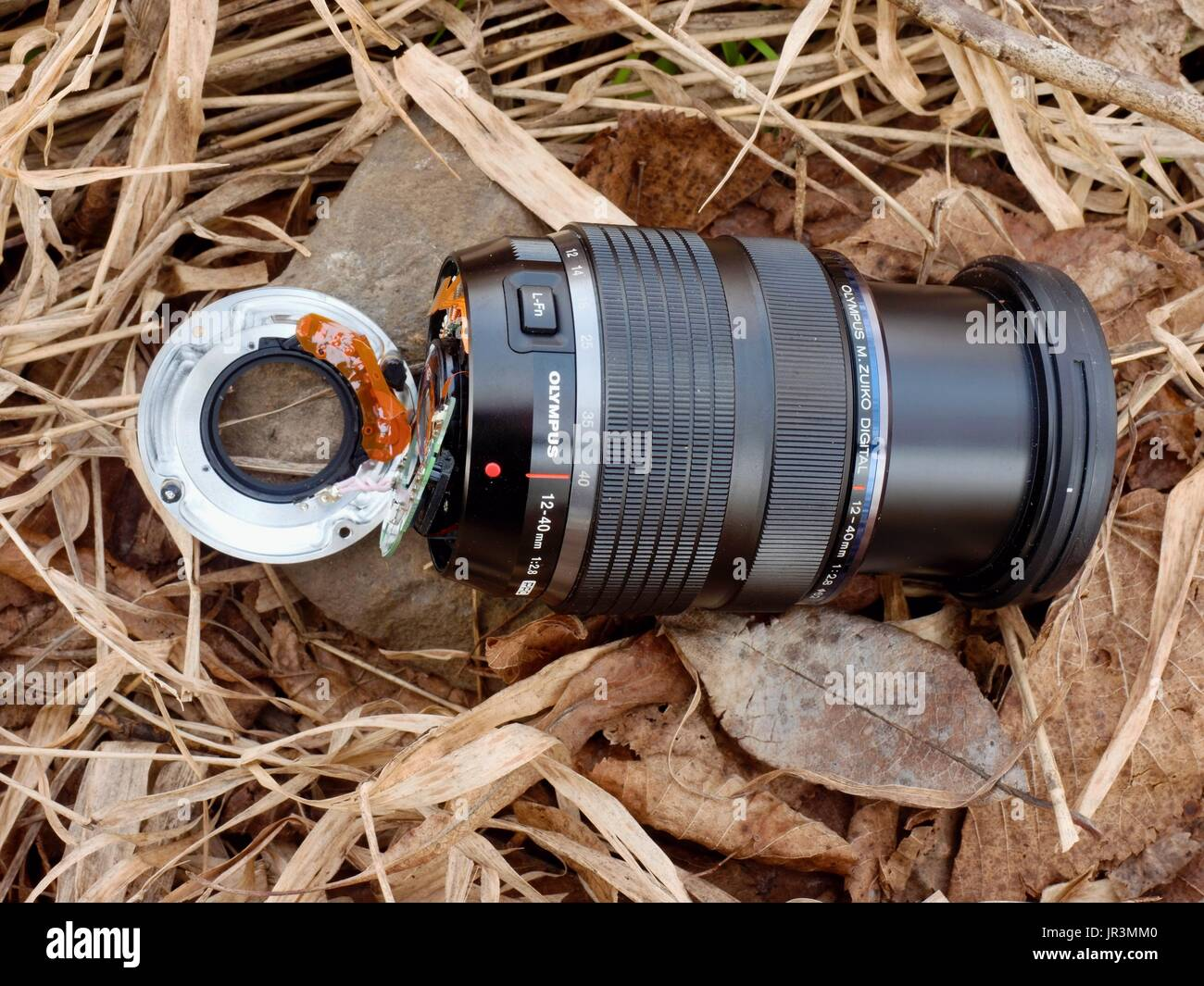 6th of February 2017. My Olympus 12-40 f2.8 lens with camera fall down from bridge to stones in river. The mount broke electronics in lens body and de - Stock Image