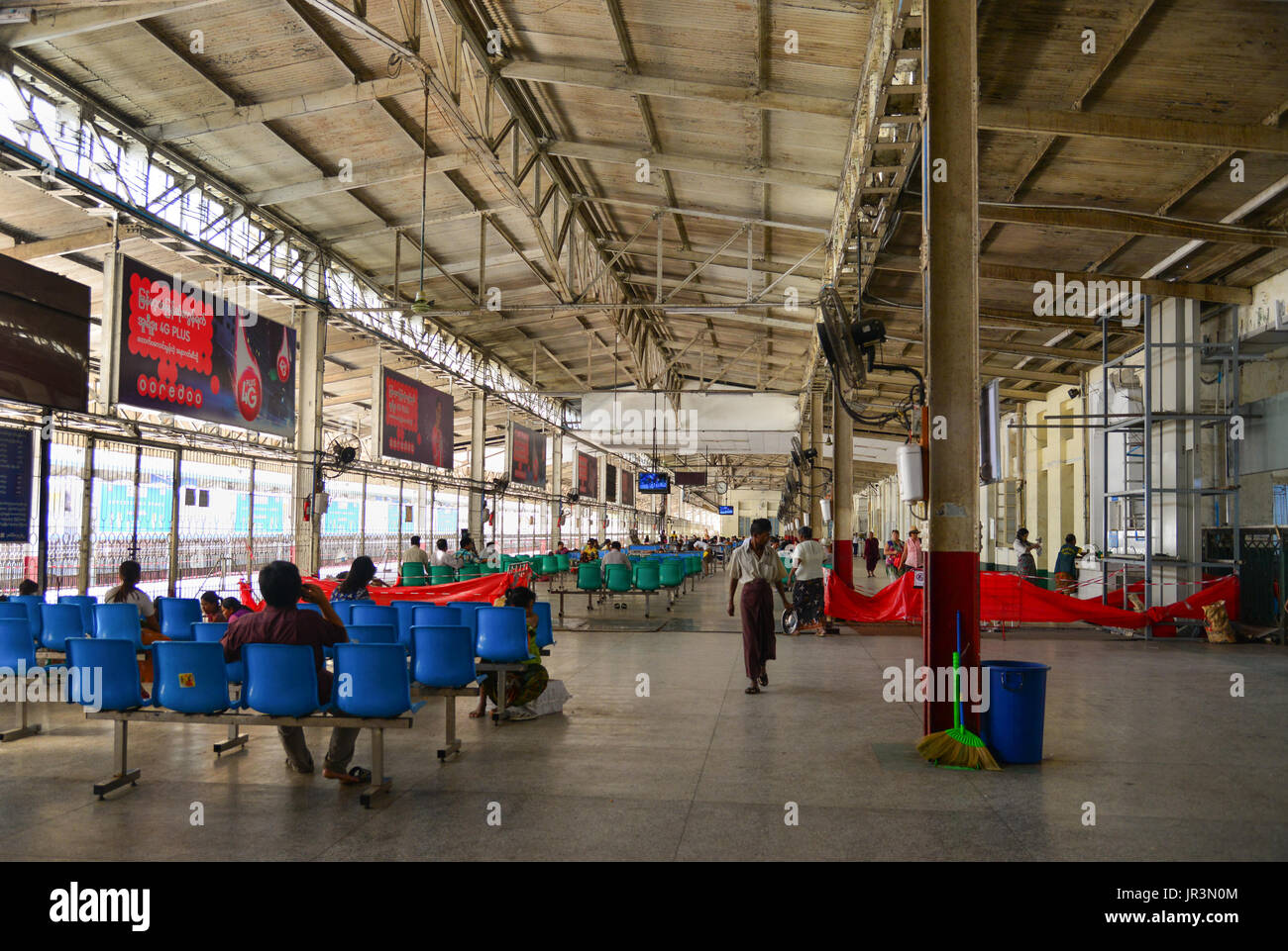 Yangon, Myanmar - Feb 13, 2017. People at waiting room of the Central Railway Station in Yangon, Myanmar. Yangon Stock Photo