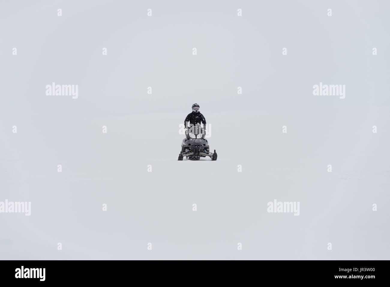 snowmobile scooter whiteout mountain - Stock Image