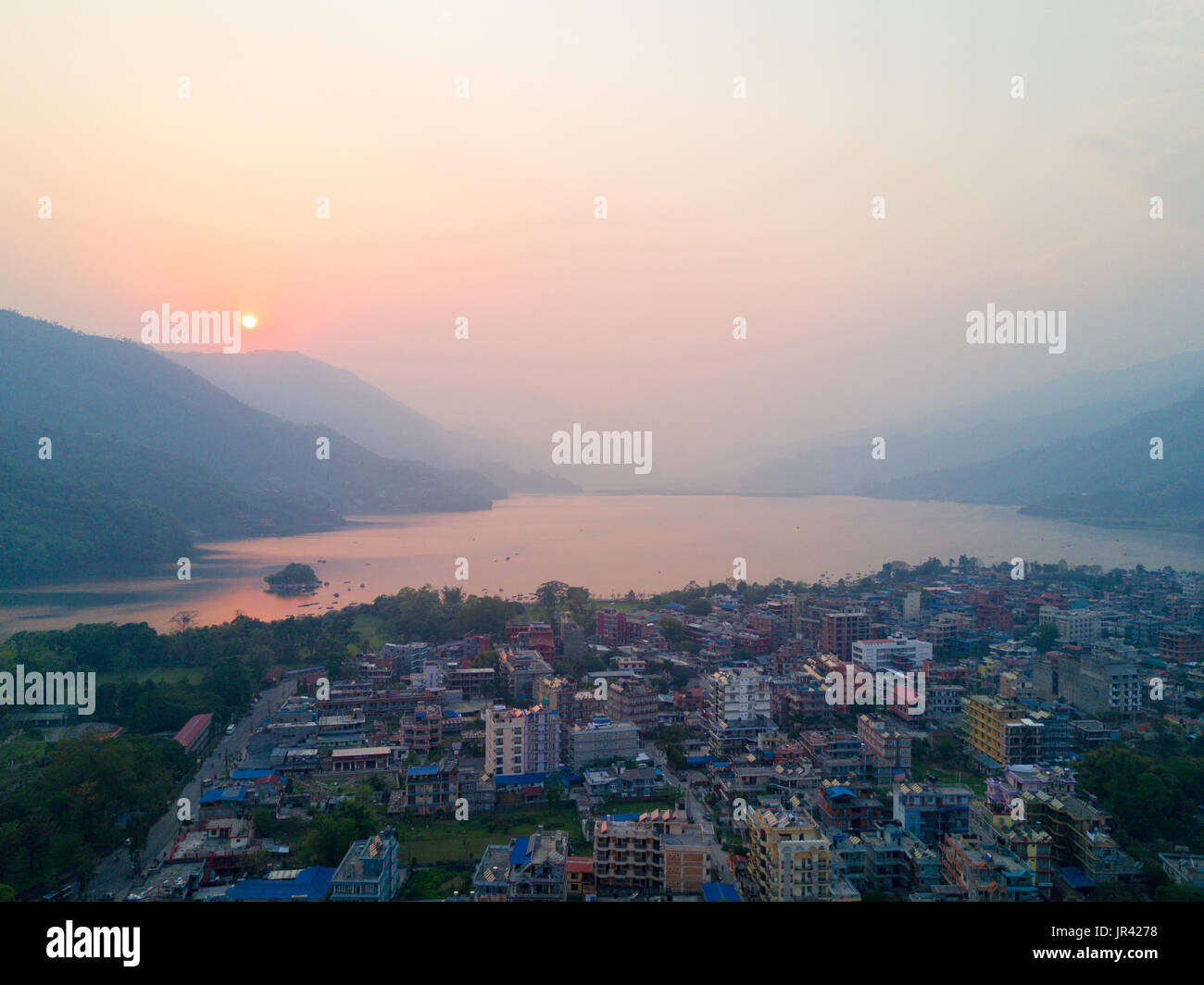 High angle aerial view over Lakeside and Phewa Lake at evening sunset in tourist destination of Pokhara, Nepal - Stock Image