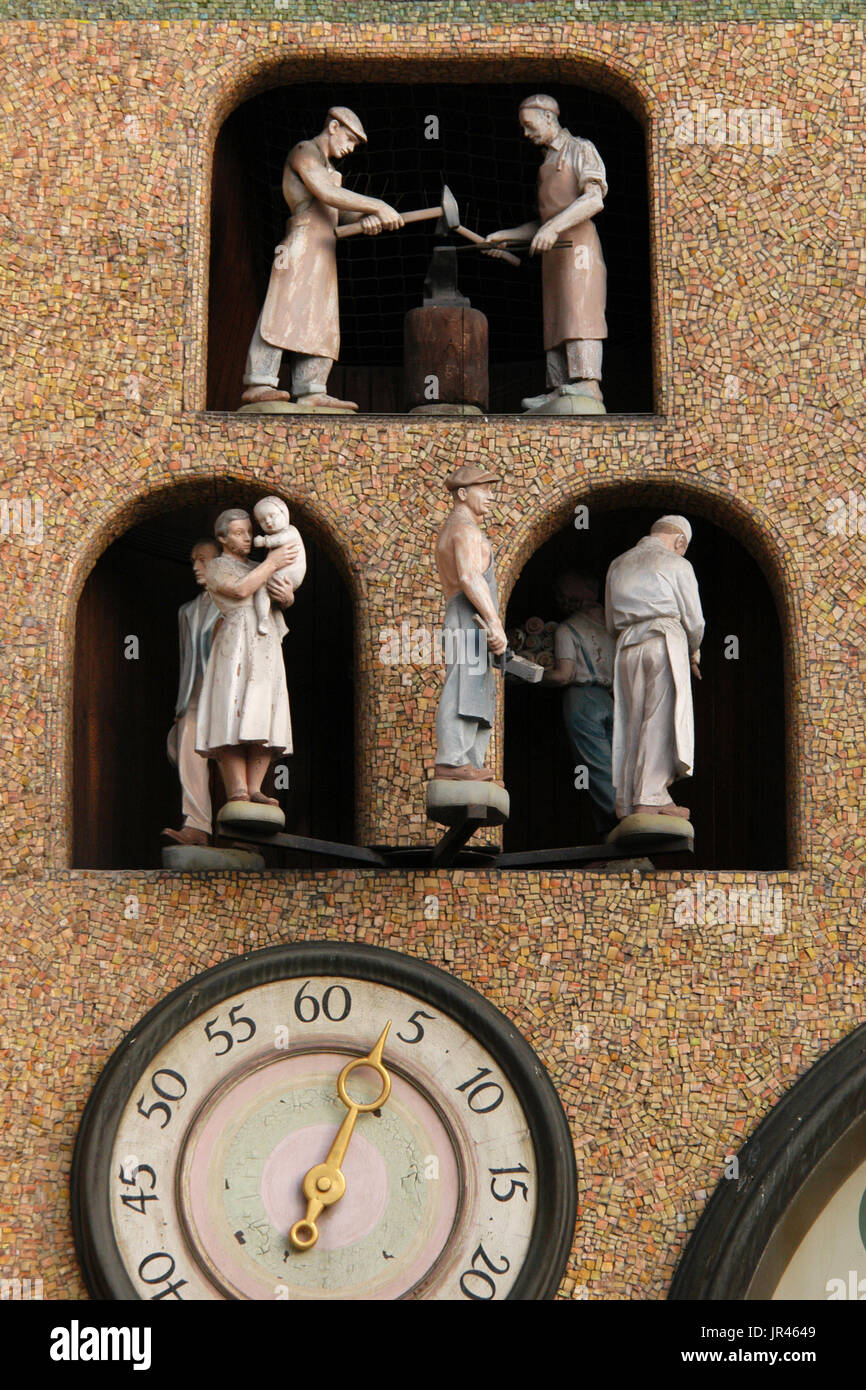 Workers and blacksmiths depicted on the Astronomical clock in Olomouc, Czech Republic. The historical clock once placed outside the Olomouc City Hall was seriously damaged during World War II and rebuild in socialist realism style by Czech artist Karel Svolinský in the 1950s. - Stock Image