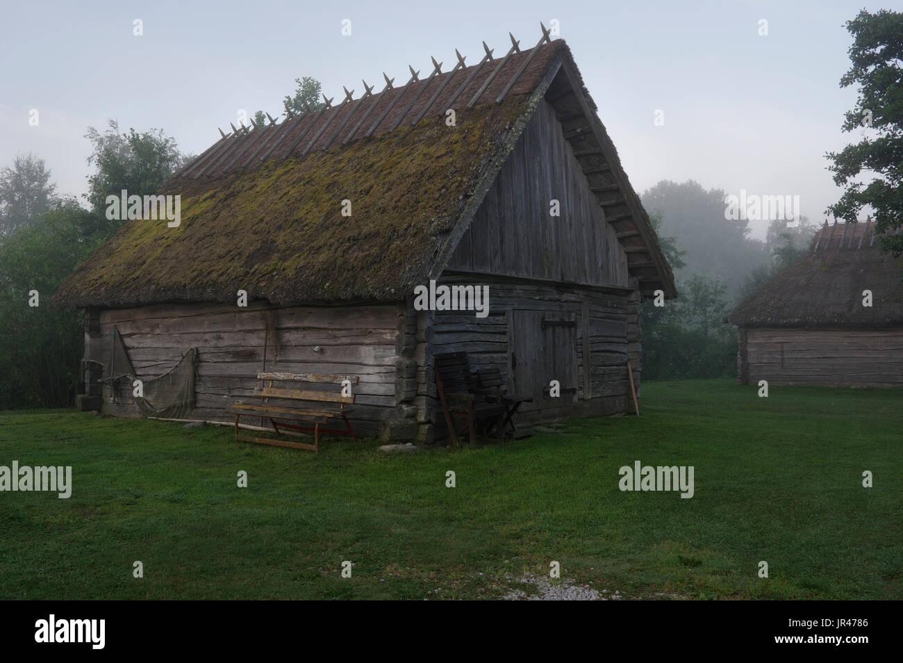 Fisherman's hut early foggy morning at Suitsu river, Matsalu National Park, Estonia, Europe - Stock Image
