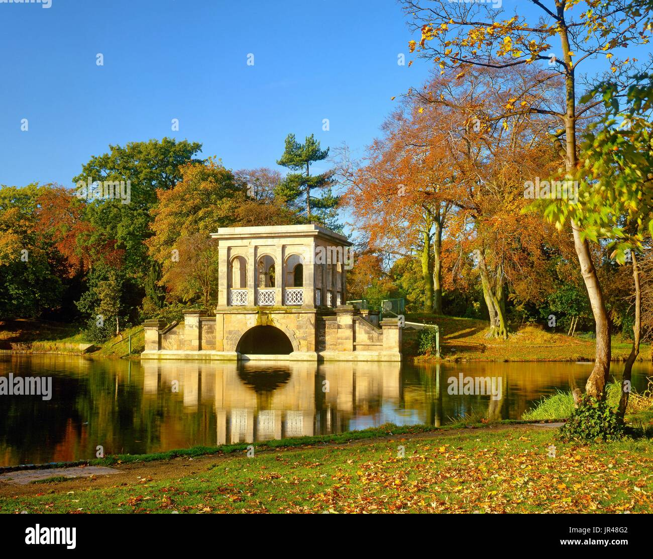 An autumn view of the boathouse in Birkenhead Park, Wirral, England - Stock Image